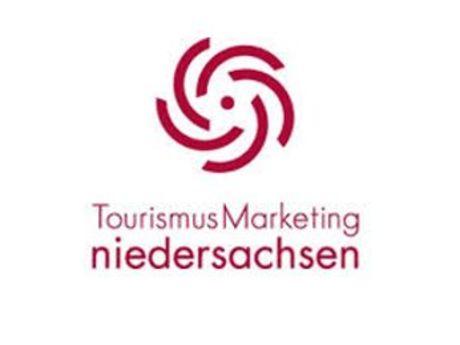 rote Spirale und darunter die Worte Tourismus Marketing niedersachsen